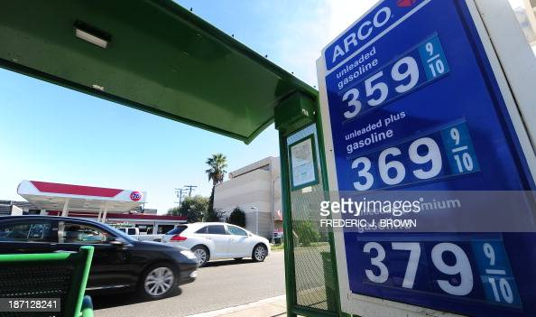 Gas prices are displayed at a station in Alhambra California on November 6 2013 where the average price for a gallon of selfserve regular gasoline...
