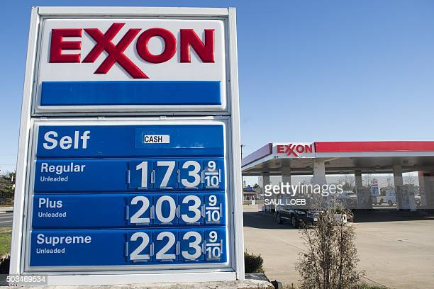 Gas prices are displayed at an Exxon gas station in Woodbridge Virginia January 5 2016 Oil prices fell further January 5 as the crude supply glut...