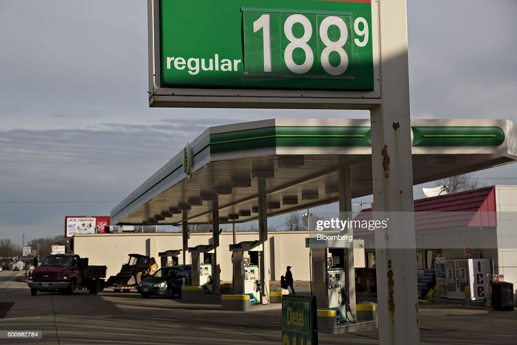 Gas prices are displayed on a sign outside a fueling station in Chillicothe Illinois US on Friday Dec 11 2015 The cost of a gallon of regular...