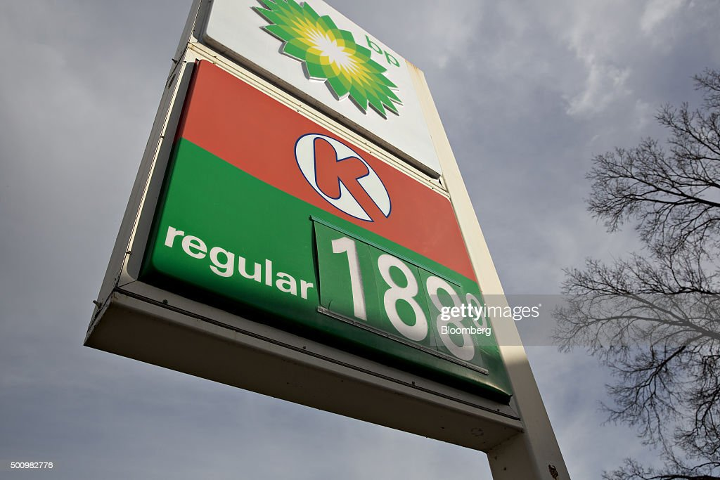 Gas prices are displayed on a sign outside a gas station in Chillicothe Illinois US on Friday Dec 11 2015 The cost of a gallon of regular gasoline...