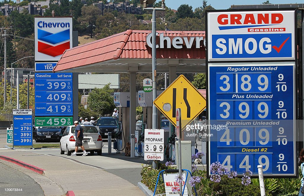 Gas prices over $4 per gallon are displayed at two gas stations July 29, 2011 in Mill Valley, California. The U.S. Commerce Department reported today that the U.S. economy slowed in the second quarter with the GDP coming in at 1.3 percent, far lower than expected.