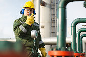 Worker with safety equipment on oil plant