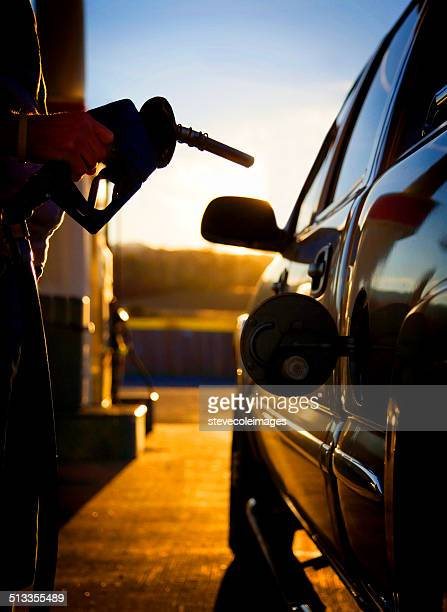 Gas pump filling up a car.