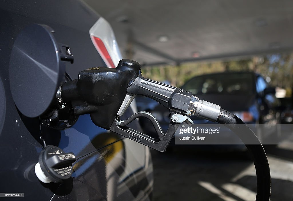 A gas pump nozzle sits in a car at a Chevron gas station on March 1, 2013 in San Francisco, California. The California Board of Equalization voted on Thursday to implement a statewide excise tax on gasoline starting July 1 that will increase the tax by 3.5 cents to 39.5 cents per gallon.