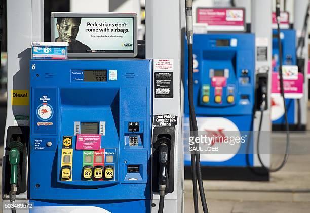 Gas pumps at a Mobil gas station in Woodbridge Virginia January 5 2016 AFP PHOTO / SAUL LOEB / AFP / SAUL LOEB