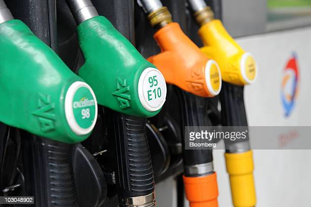 Gas pumps hang at a Total SA gas station in Paris France on Thursday July 22 2010 The company Europe's biggest oil refiner releases its earnings next...