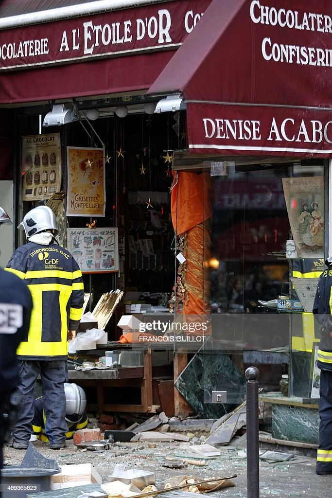 Gas response firemen search the site of a blast that occurred at chocolate shop 'A l'Etoile d'Or' in the Paris 9th district, on February 14, 2014. Five people were injured, one seriously, on February 14, 2014 in an explosion at a construction site in a chocolate shop in Paris. The wounded are all workers who were working on the site. AFP PHOTO / FRANCOIS GUILLOT