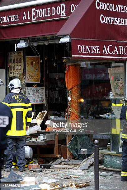 Gas response firemen search the site of a blast that occurred at chocolate shop 'A l'Etoile d'Or' in the Paris 9th district on February 14 2014 Five...