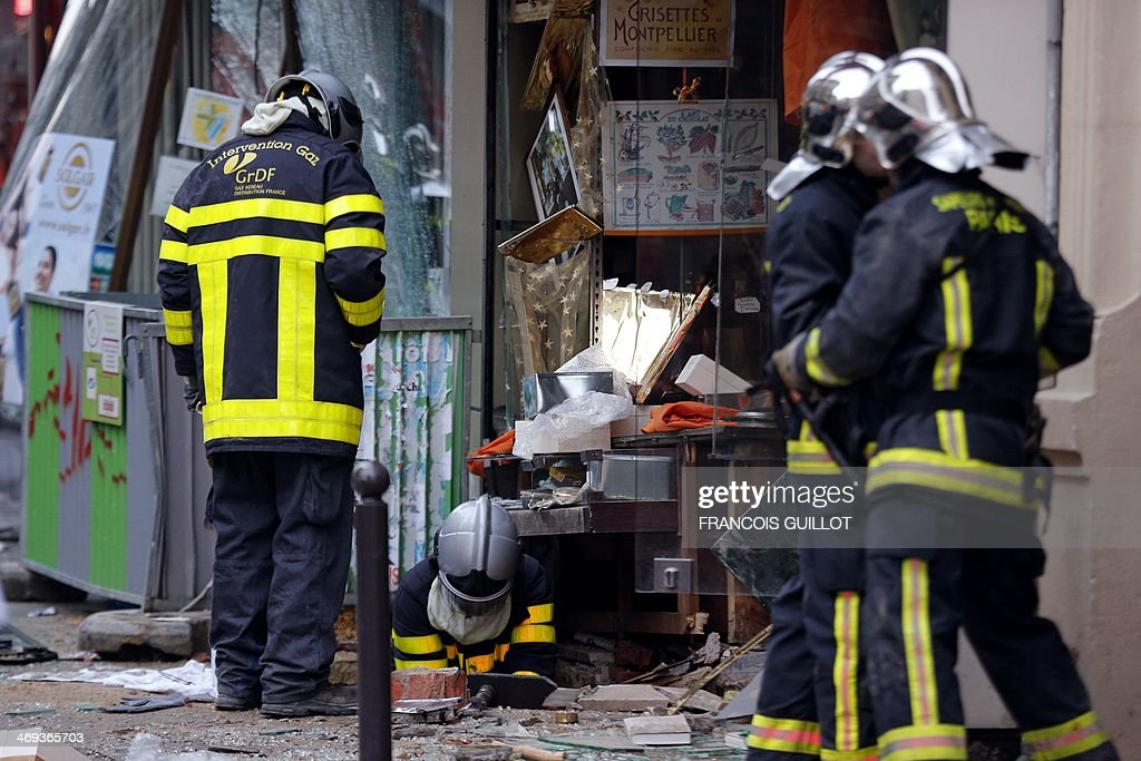 Gas response firemen search the site of a blast that occurred at chocolate shop 'A l'Etoile d'Or' in the Paris 9th district, on February 14, 2014. Five people were injured, one seriously, on February 14, 2014 in an explosion at a construction site in a chocolate shop in Paris. The wounded are all workers who were working on the site.