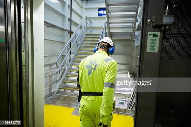 A gas rig worker moves between floors aboard the Troll A natural gas platform operated by Statoil ASA in the North Sea Norway on Wednesday Oct 21...