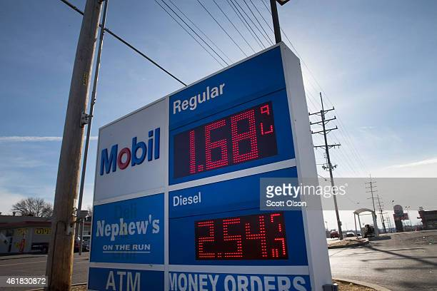A gas station advertises gasoline for $168 a gallon on January 20 2015 in Dellwood Missouri Nationwide gas prices are averaging $205 a gallon their...