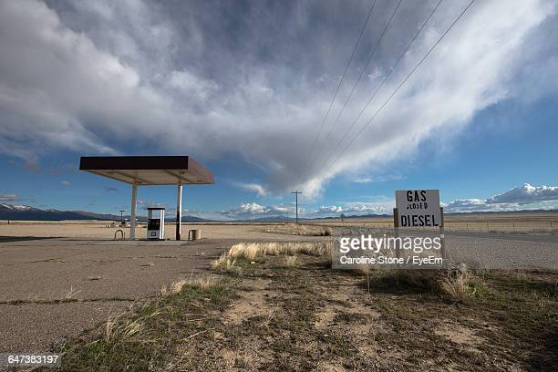 Gas Station At Remote Area Against Cloudy Sky