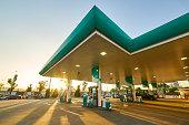 Gas station at sunrise morning .