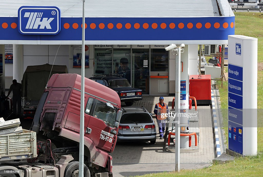 tnk bp gas stations ahead of bp stake photos and images a gas station attendant works on the forecourt of a tnk bp gas station on