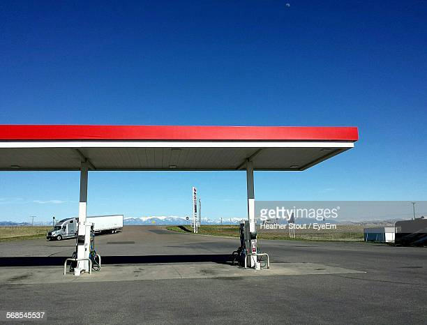 Gas Station By Road Against Clear Blue Sky