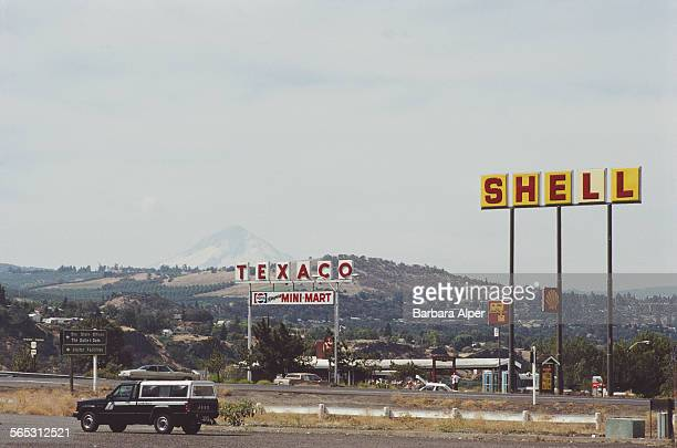 Gas stations on a road in The Dalles Oregon USA August 1987