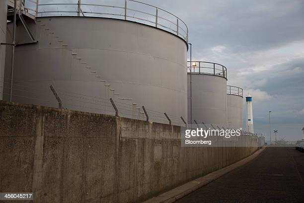 Gas storage silos stand behind a concrete wall at Aberdeen Harbour operated by the Aberdeen Harbour Board in Aberdeen UK on Thursday Dec 12 2013 A...