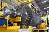 gas turbine rotor being serviced at workshop