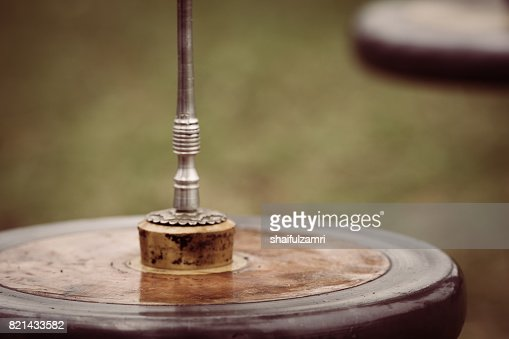 'Gasing' or tops spinning, is a traditional games popular among Malay in Malaysia. : Stock Photo