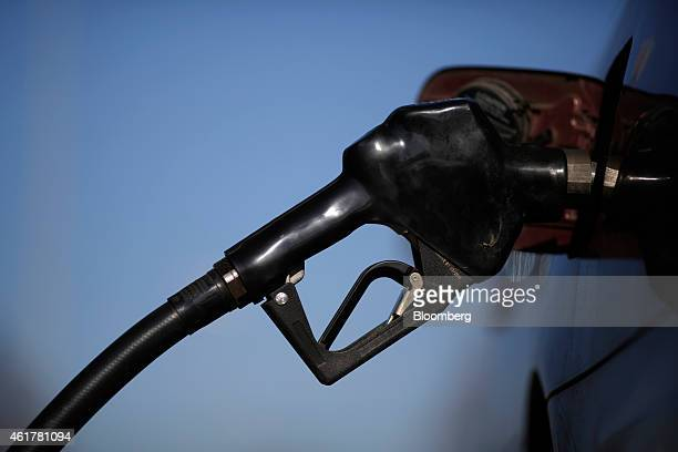 A gasoline nozzle is inserted into a vehicle's gas tank during refueling at a a Royal Dutch Shell Plc gas station in Portland Tennessee US on Friday...