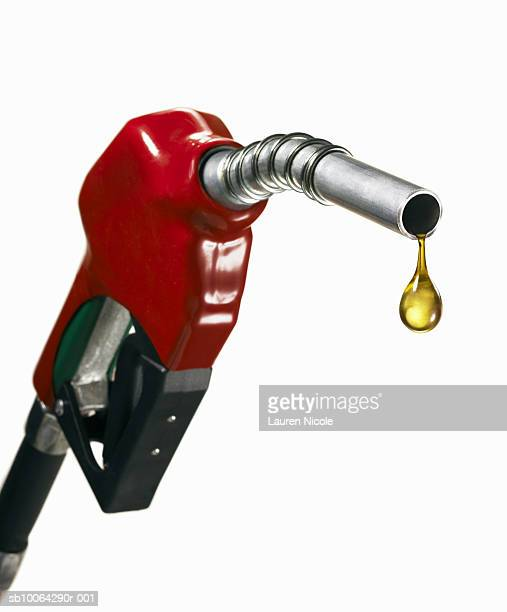 Gasoline nozzle with drop of oil, close-up