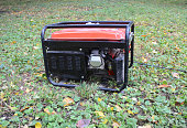 Gasoline Portable Generator. Close up on Mobile Backup Generator in the garden. Standby Generator - Outdoor Power Equipment