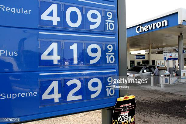 Gasoline prices above $400 per gallon are displayed while a man refuels his truck at a Chevron Corp gas station in Goleta California US on Friday...