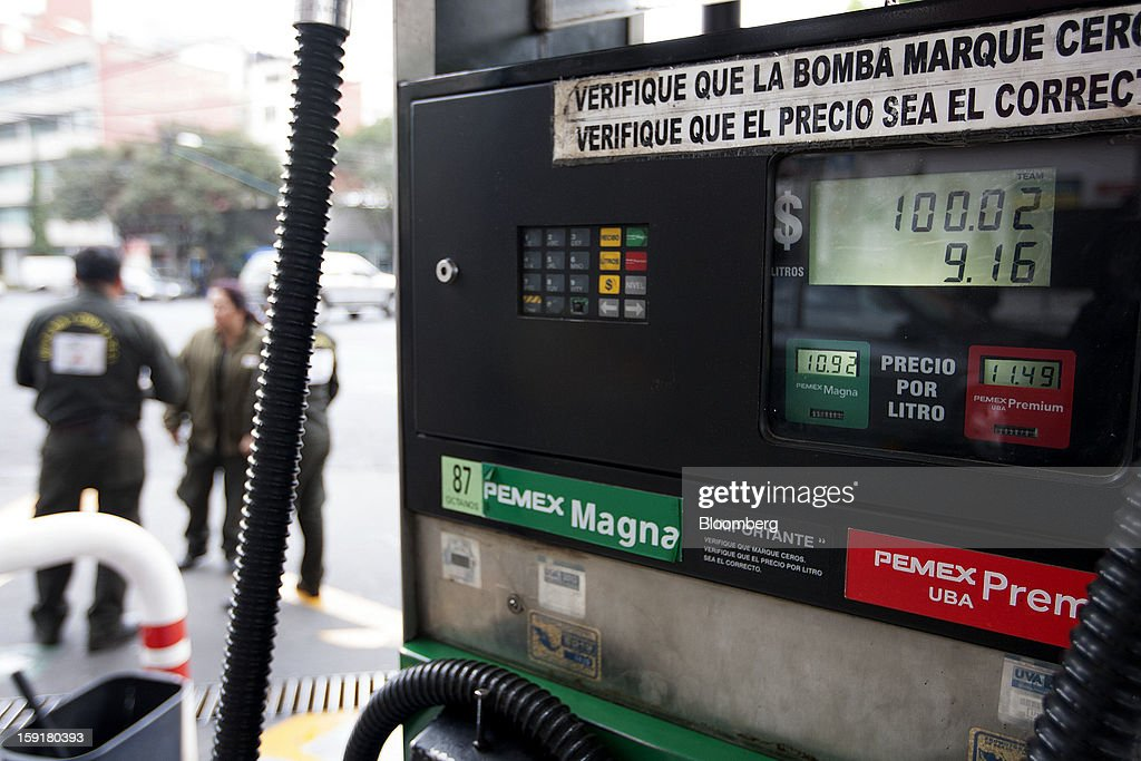 Gasoline prices are displayed on a pump at a Pemex station in Mexico City, Mexico, on Tuesday, Jan. 8, 2013. Mexico's government is speeding up the removal of subsidies on gasoline and increasing local unleaded gasoline prices by 11 centavos in January, according to the Finance Ministry. Photographer: Susana Gonzalez/Bloomberg via Getty Images