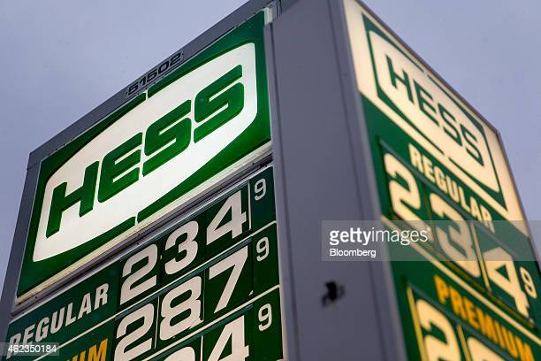 Gasoline prices are displayed on signs at a Hess Corp gas station in Washington DC US on Monday Jan 26 2015 Hess Corp is expected to report...
