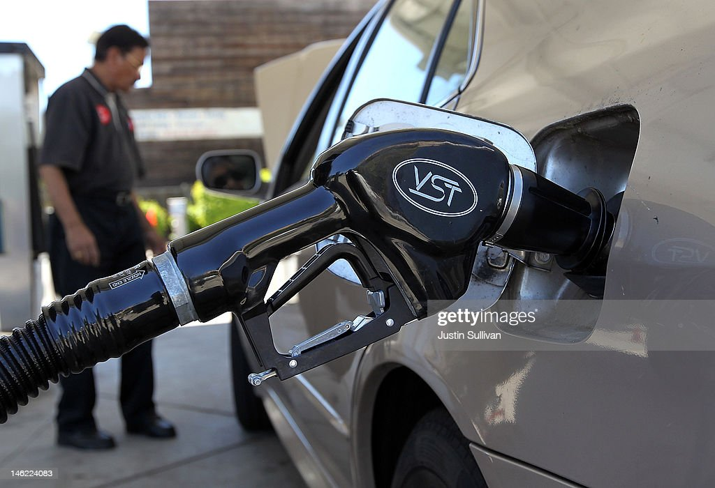A gasoline pump rests in the tank of a car on June 12, 2012 in San Anselmo, California. According to the Energy Department's weekly fuel survey, the average pump price in California dropped 9.6 cents in the past week to bring the price of a gallon of regular gasoline to $4.164 compared to $4.260 one week earlier.