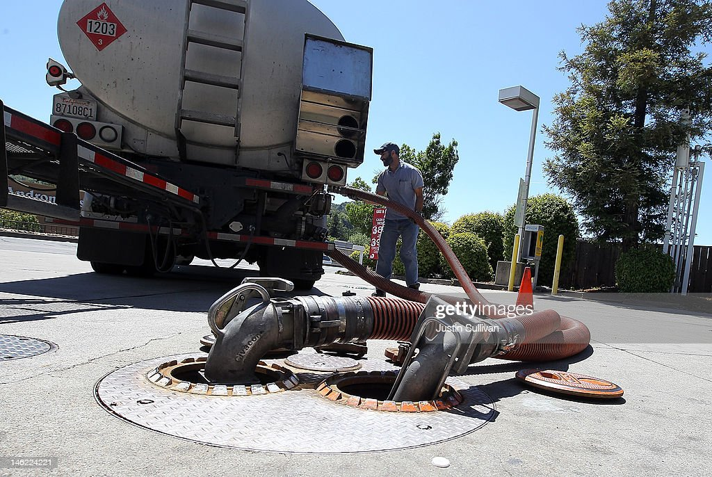Gasoline truck driver Bhupinder Singh makes a gasoline delivery to a gas station on June 12, 2012 in San Anselmo, California. According to the Energy Department's weekly fuel survey, the average pump price in California dropped 9.6 cents in the past week to bring the price of a gallon of regular gasoline to $4.164 compared to $4.260 one week earlier.