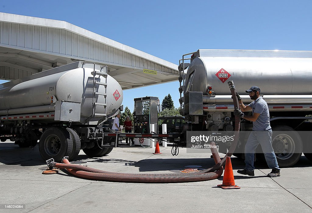 Gasoline truck driver Bhupinder Singh moves a fuel hose as he makes a gasoline delivery to a gas station on June 12, 2012 in San Anselmo, California. According to the Energy Department's weekly fuel survey, the average pump price in California dropped 9.6 cents in the past week to bring the price of a gallon of regular gasoline to $4.164 compared to $4.260 one week earlier.
