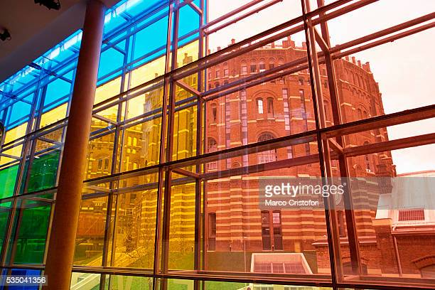 Gasometer Buildings in Vienna Through Yellow and Blue Windows