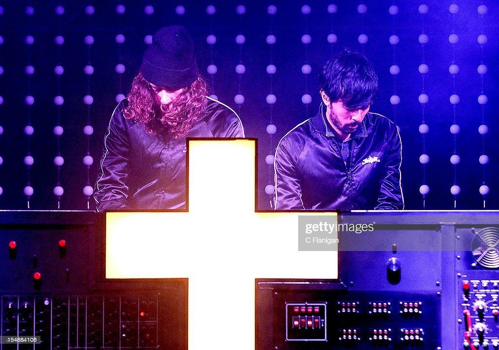 Gaspard Auge and Xavier de Rosnay of Justice perform during the 2012 Voodoo Experience at City Park on October 27, 2012 in New Orleans, Louisiana.