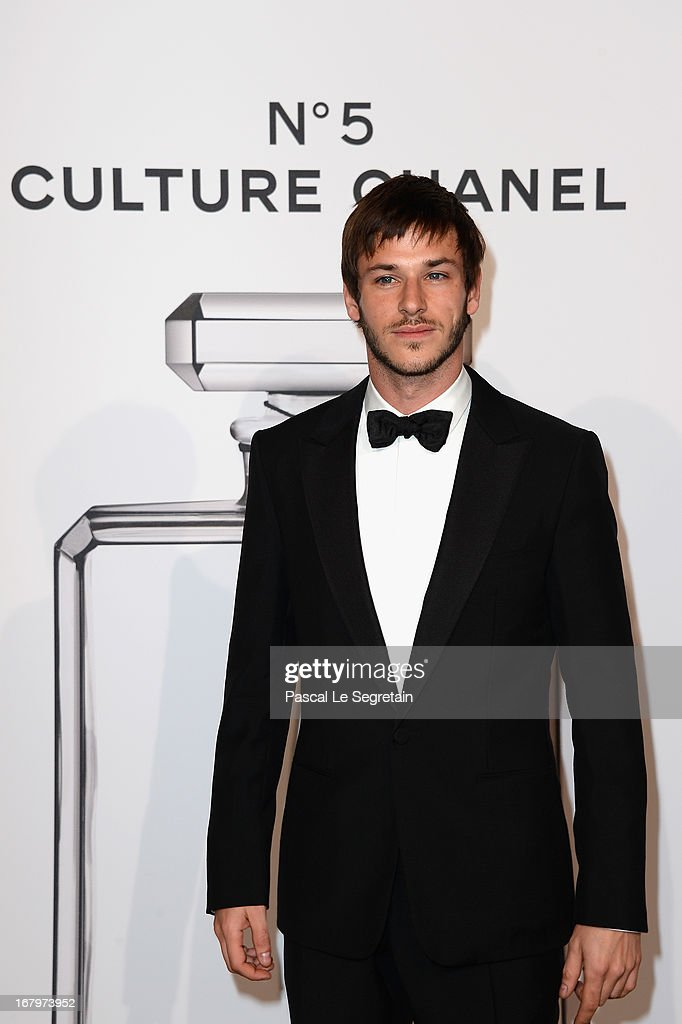 <a gi-track='captionPersonalityLinkClicked' href=/galleries/search?phrase=Gaspard+Ulliel&family=editorial&specificpeople=241206 ng-click='$event.stopPropagation()'>Gaspard Ulliel</a> poses during a photocall for 'N°5 Culture Chanel' exhibition at Palais De Tokyo on May 3, 2013 in Paris, France.