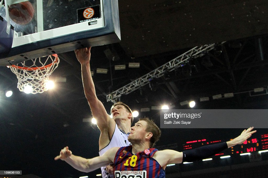 Gasper Vidmar #13 of Besiktas JK Istanbul competes with C.J. Wallace #18 of FC Barcelona Regal during the 2012-2013 Turkish Airlines Euroleague Top 16 Date 4 between Besiktas JK Istanbul v FC Barcelona Regal at Abdi Ipekci Sports Arena on January 17, 2013 in Istanbul, Turkey.