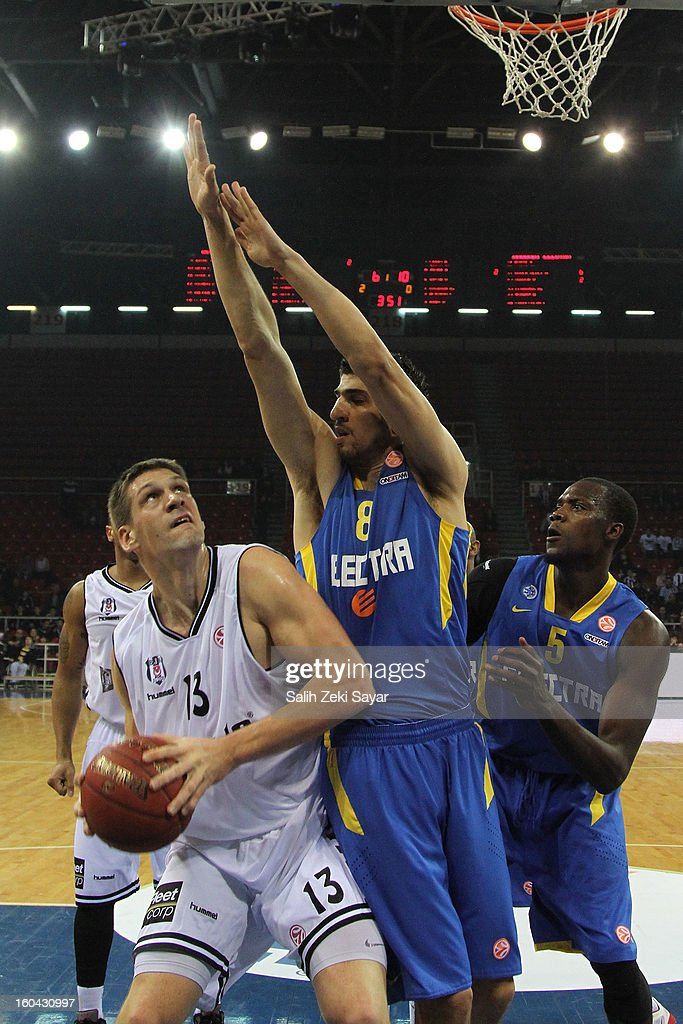 Gasper Vidmar #13 of Besiktas JK Istanbul competes with Lior Eliyahu #8 and Shawn James #5 of Maccabi Electra during the 2012-2013 Turkish Airlines Euroleague Top 16 Date 6 between Besiktas JK Istanbul v Maccabi Electra Tel Aviv at Abdi Ipekci Sports Arena on January 31, 2013 in Istanbul, Turkey.