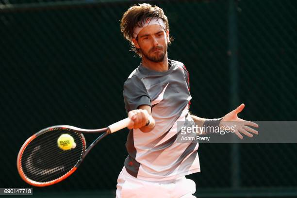 Gastao Elias of Portugal plays a forehand during the mens singles first round match against Kyle Edmund of Great Britain on day three of the 2017...