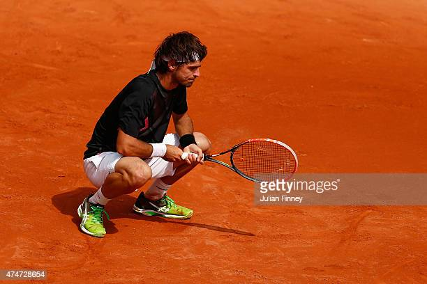 Gastao Elias of Portugal reacts during the men's singles match against Benoit Paire of France on day two of the 2015 French Open at Roland Garros on...