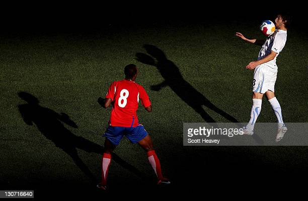 Gaston Alexis Silva of Uruguay in action with Jorge Alexander Davis of Costa Rica during the Men's Football Bronze Medal match between Costa Rica and...