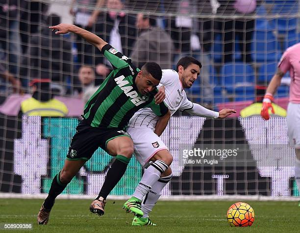 Gaston Brugman of Palermo and Gregoire Defrel of Sassuolo compete for the ball during the Serie A match between US Sassuolo Calcio and US Citta di...