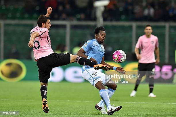 Gaston Brugman of Palermo and Ogenyi Onazi of Lazio compete for the ball during the Serie A match between US Citta di Palermo and SS Lazio at Stadio...