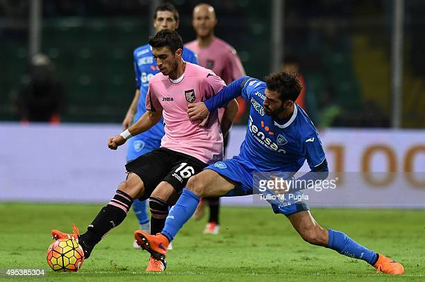 Gaston Brugman of Palermo and Riccardo Saponara of Empoli compete for the ball during the Serie A match between US Citta di Palermo and Empoli FC at...