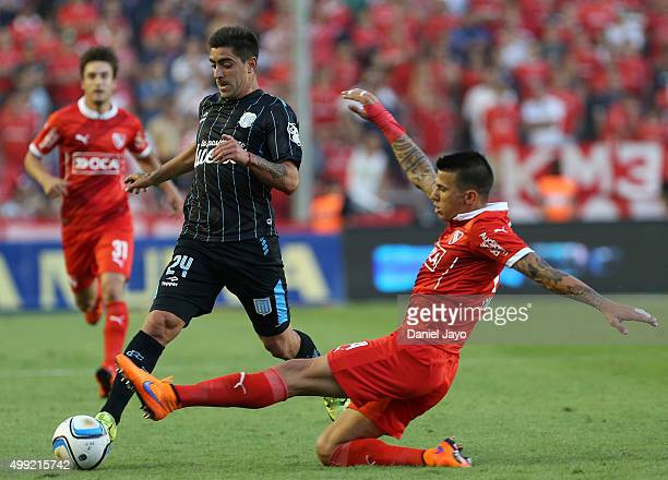 Gaston Diaz of Racing Club and Jorge Ortiz of Independiente battle for the ball during a first leg match between Independiente and Racing Club as...