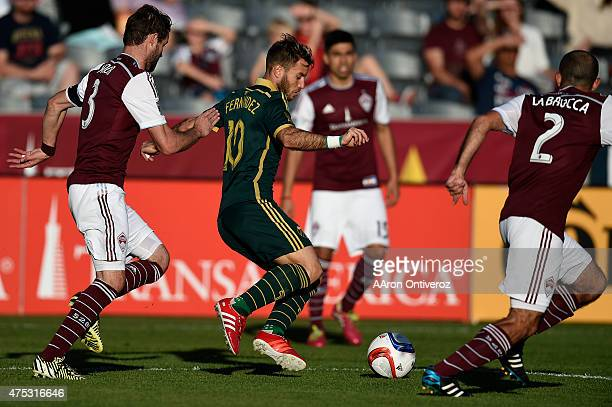 Gaston Fernandez of Portland Timbers controls the ball as Drew Moor of Colorado Rapids defends during the first half of action The Colorado Rapids...