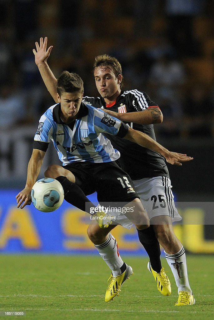 Gaston Gil Romero (R) of Estudiantes de La Plata fights for the ball with Luciano Vietto (L) of Racing Club during a match as part of the 7th round of the Torneo Final 2013 at Ciudad de La Plata stadium on March 30, 2013 in La Plata, Argentina.