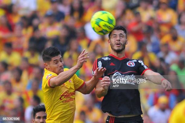 Gaston Lascano of Morelia jumps for the ball with Guido Rodriguez of Tijuana during their first leg of quarterfinal of Mexican Clausura 2017...