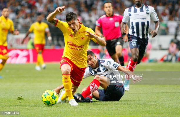 Gaston Lezcano of Morelia and Luis Fuentes of Monterrey fight for the ball during the 17th round match match between Monterrey and Morelia as part of...