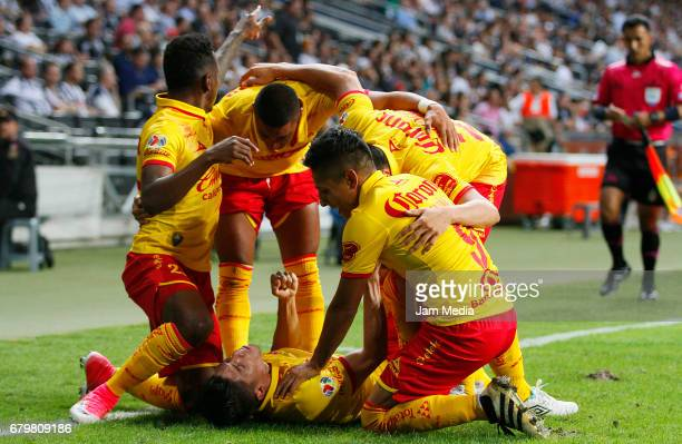 Gaston Lezcano of Morelia celebrates with teammates his team's first goal during the 17th round match match between Monterrey and Morelia as part of...