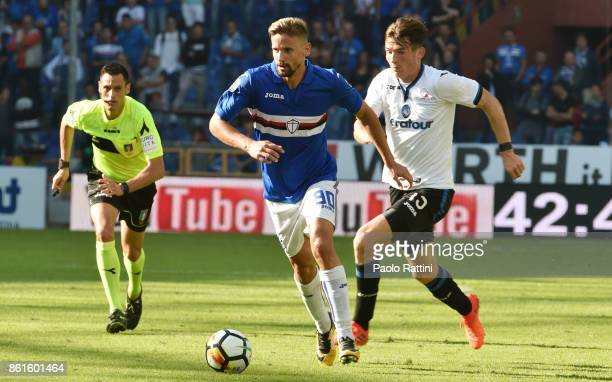 Gaston Ramirez and Marten De Roon during the Serie A match between UC Sampdoria and Atalanta BC at Stadio Luigi Ferraris on October 15 2017 in Genoa...